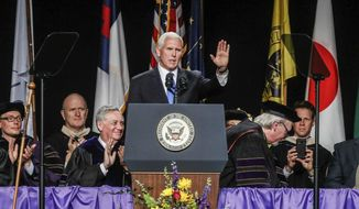 Vice President Mike Pence, gives the commencement address during the Taylor University commencement ceremony, Saturday, May 18, 2019 in Upland, Ind. Dozens of graduates and faculty have protested the selection of Vice President Mike Pence as the commencement speaker at Taylor University in Indiana by walking out moments before his introduction.(Michelle Pemberton/The Indianapolis Star via AP)