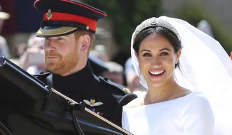 FILE - In this Saturday, May 19, 2018 file photo, Britain's Prince Harry and his wife Meghan Markle leave after their wedding ceremony, at St. George's Chapel in Windsor Castle in Windsor, near London, England. Sunday, May 19, 2019 marks the first wedding anniversary of the besotted couple. (Gareth Fuller/pool photo via AP, File)