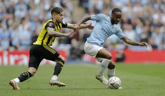 Manchester City's Raheem Sterling, right, challenges for the ball with Watford's Kiko Femenia during the English FA Cup Final soccer match between Manchester City and Watford at Wembley stadium in London, Saturday, May 18, 2019. (AP Photo/Kirsty Wigglesworth)