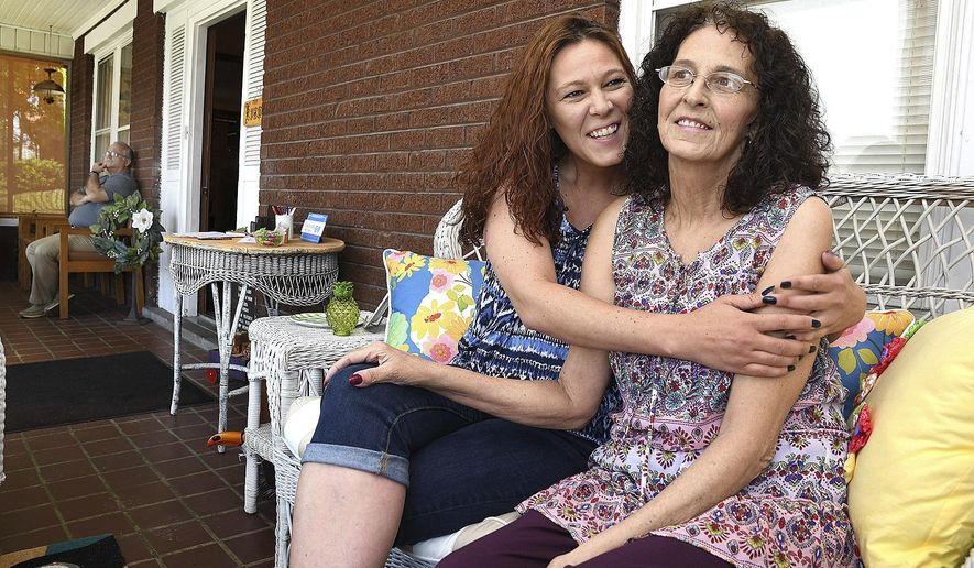 Shannon Barbero, of Beckley, W.Va. hugs her mother Tammy Evans, of Beckley at her moms home on May 6, 2019, one month after she donating half her liver to save her mothers life. (Rick Barbero/The Register-Herald via AP)