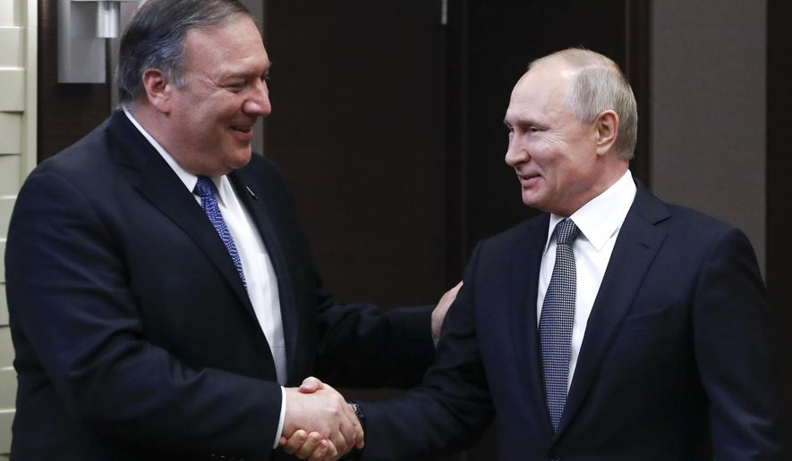 In this May 14, 2019, photo, Russian President Vladimir Putin, right, and U.S. Secretary of State Mike Pompeo, shake hands prior to their talks in the Black Sea resort city of Sochi, southern Russia. (AP Photo/Pavel Golovkin, Pool)