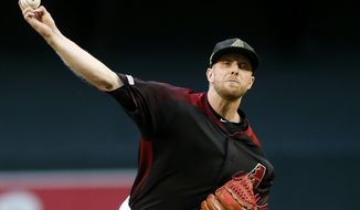 Arizona Diamondbacks starting pitcher Merrill Kelly throws against the San Francisco Giants during the first inning of a baseball game, Friday, May 17, 2019, in Phoenix. (AP Photo/Ralph Freso)