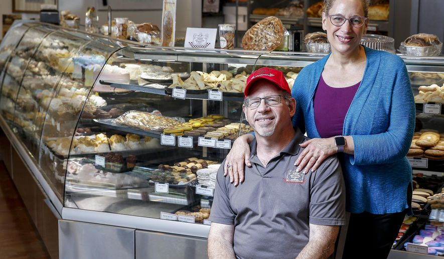 In this Aug. 17, 2018, photo Three Brothers Bakery owners Bobby and Janice Jucker stand for a portrait at their South Braeswood Boulevard location in Houston. (Michael Ciaglo/Houston Chronicle via AP)