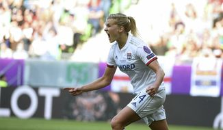 Ada Hegerberg of Lyon celebrates after scoring a goal during the women's soccer UEFA Champions League final match between Olympique Lyon and FC Barcelona at the Groupama Arena in Budapest, Hungary, Saturday, May 18, 2019. (Tibor Illyes/MTI via AP)