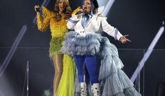 Israeli singer Dana International, left, the winner of the 1998 Eurovision Song Contest and Israeli Netta Barzilai, the winner of the 2018 Eurovision Song Contest perform during the 2019 Eurovision Song Contest grand final in Tel Aviv, Israel, Saturday, May 18, 2019. (AP Photo/Sebastian Scheiner)