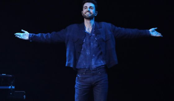 """Duncan Laurence of the Netherlands reacts after performing his song """"Arcade"""" during the 2019 Eurovision Song Contest grand final in Tel Aviv, Israel, Saturday, May 18, 2019. (AP Photo/Sebastian Scheiner)"""