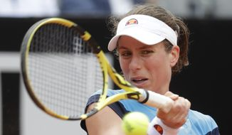 Johanna Konta of Britain returns the ball to Kiki Bertens of the Netherlands during a semifinal match at the Italian Open tennis tournament, in Rome, Saturday, May 18, 2019. (AP Photo/Andrew Medichini)
