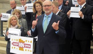 Republican Minnesota State Sen. Roger Chamberlain speaks at a news conference on the steps of the Minnesota Capitol with his fellow GOP senators after the Senate passed his bill for preventing a state government shutdown if the Legislature's budget stalemate persists, Saturday, May 18, 2019 in St. Paul, Minn.. The move threw down a challenge to House Democrats and Gov. Tim Walz to either agree or take the blame for a shutdown when the current budget expires June 30. (AP Photo/Steve Karnowski)