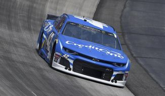 Kyle Larson (42) competes during the NASCAR Cup Series auto race, Monday, May 6, 2019, at Dover International Speedway in Dover, Del. (AP Photo/Will Newton)