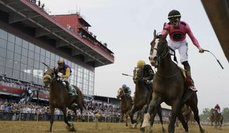War of Will, ridden by Tyler Gaffalione, right, crosses the finish line first to win the Preakness Stakes horse race at Pimlico Race Course, Saturday, May 18, 2019, in Baltimore.(AP Photo/Steve Helber) ** FILE **