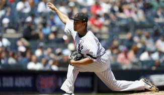 New York Yankees starter Masahiro Tanaka delivers a pitch against the Tampa Bay Rays during the second inning of a baseball game, Saturday, May 18, 2019, in New York. (AP Photo/Jim McIsaac)