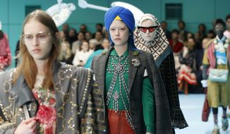 In this Feb. 21, 2018 file photo, models display items from Gucci's women's Fall/Winter 2018-2019 collection, presented during the Milan Fashion Week, in Milan, Italy. The top civil rights organization for Sikhs in the United States says Nordstrom has apologized to the community for selling an $800 turban they found offensive, but they are still waiting to hear from the Gucci brand that designed it, Saturday, May 18, 2019. (AP Photo/Antonio Calanni, File)
