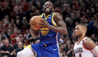 Golden State Warriors forward Draymond Green, left, prepares to shoot over Portland Trail Blazers guard Damian Lillard during the first half of Game 3 of the NBA basketball playoffs Western Conference finals Saturday, May 18, 2019, in Portland, Ore. (AP Photo/Craig Mitchelldyer) **FILE**