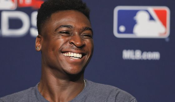 FILE - In this Oct. 7, 2018, file photo, New York Yankees shortstop Didi Gregorius answers questions during a baseball news conference in New York. Gregorius is projected to return to the New York Yankees next month, a faster recovery from Tommy John surgery than originally expected. (AP Photo/Julie Jacobson, File)