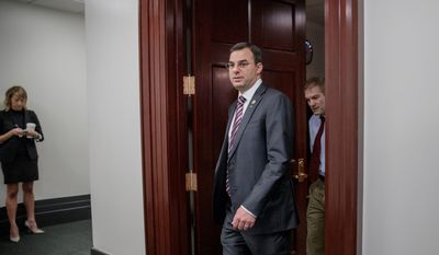 "Rep. Justin Amash said he thinks President Trump's conduct has crossed the line, suggesting he violated public trust and Congress should exercise its checks and balances authority. President Trump called Mr. Amash a ""loser"" in response. (Associated Press)"