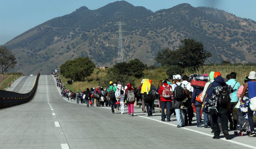 Central American migrants travel as a caravan toward the U.S. border on the highway that connects Guadalajara with Tepic, Mexico, Tuesday, Nov. 13, 2018. Many migrants say they are fleeing rampant poverty, gang violence and political instability primarily in the Central American countries of Honduras, Guatemala, El Salvador and Nicaragua. (AP Photo/Rodrigo Abd) ** FILE **