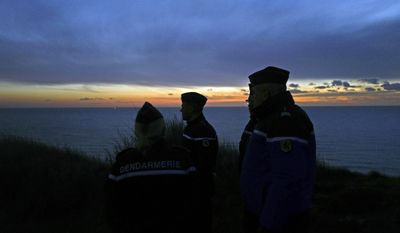 French gendarmes patrol the beach in Ambleteuse near Calais, northern France, Friday, Jan. 18, 2019. Land, sea and air patrols are combing the beaches, dunes and frigid, murky coastal waters of northern France in a bid to end an unusual high-risk tactic by migrants, mostly Iranians: trying to sneak across the English Channel in rubber rafts. (AP Photo Michel Spingler)