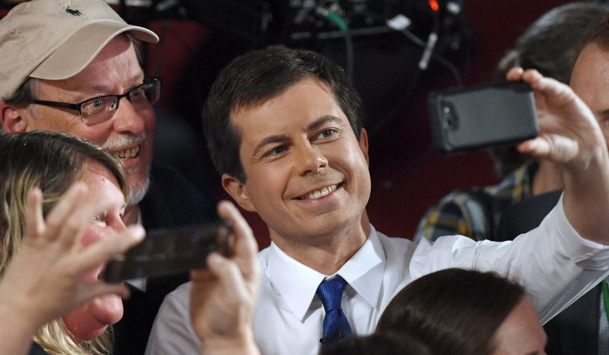 Democratic presidential candidate South Bend, Ind., Mayor Pete Buttigieg takes a selfie with audience members after a FOX News Channel town hall, Sunday, May 19, 2019, in Claremont, N.H. (AP Photo/Jessica Hill)