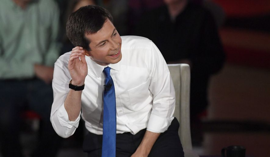 Democratic presidential candidate South Bend, Ind., Mayor Pete Buttigieg laughs as a member of the audience jokes with him during a commercial break during a FOX News Channel Town Hall moderated by Chris Wallace, Sunday, May 19, 2019, in Claremont, N.H. (AP Photo/Jessica Hill)
