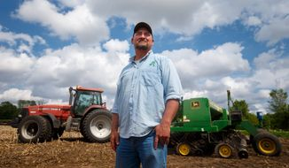 In this May 22, 2019, photo, farmer Tim Bardole pauses for a photo as he plants a field near Perry, Iowa. Donald Trump won the presidency by winning rural America, in part by pledging to use his business savvy and tough negotiating skills to take on China and put an end to trade practices that have hurt farmers for years. While the prolonged fight has been devastating to an already-struggling agriculture industry, theres little indication Trump is paying a political price. (Zach Boyden-Holmes/The Des Moines Register via AP)