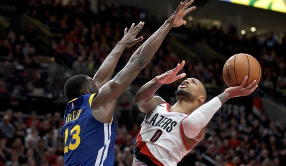 Portland Trail Blazers guard Damian Lillard, right, shoots over Golden State Warriors forward Draymond Green during the second half of Game 3 of the NBA basketball playoffs Western Conference finals Saturday, May 18, 2019, in Portland, Ore. The Warriors won 110-99. (AP Photo/Craig Mitchelldyer)