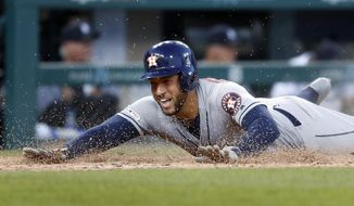 Houston Astros' George Springer slides safely into home plate for an inside-the-park home run during the fifth inning of the team's baseball game against the Detroit Tigers in Detroit, Tuesday, May 14, 2019. (AP Photo/Paul Sancya)