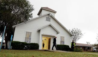 FILE - In this Nov. 12, 2017, file photo, a man walks out of the memorial for the victims of a shooting at Sutherland Springs First Baptist Church in Sutherland Springs, Texas. A South Texas church where a gunman in 2017 opened fire and killed more than two dozen congregants will unveil a new sanctuary and memorial room honoring the victims. Worshippers and relatives of those killed or injured at the First Baptist Church in Sutherland Springs are expected to gather at the newly constructed church on Sunday, May 19, 2019. (AP Photo/Eric Gay, File)