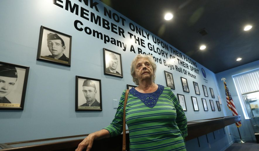 In this May 6, 2019, photo, Marguerite Cottrell, sister of John Reynolds, speaks during an interview at a recently opened tribute center for the Bedford Boys in Bedford, Va. Reynolds, had been killed in the D-Day invasion of Normandy on the coast of France. The 75th anniversary of the D-Day invasion of Normandy has a solemn significance for the small town of Bedford, who lost 20 local men. (AP Photo/Steve Helber)