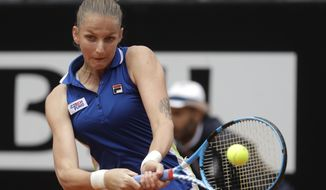 Karolina Pliskova, of the Czech Republic, returns a shot to Johanna Konta, of Britain during their final match at the Italian Open tennis tournament, in Rome, Sunday, May 19, 2019. (AP Photo/Gregorio Borgia)