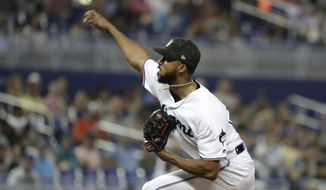 Miami Marlins starting pitcher Sandy Alcantara throws in the sixth inning during a baseball game against the New York Mets, Sunday, May 19, 2019, in Miami. (AP Photo/Lynne Sladky)