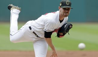 Cleveland Indians starting pitcher Shane Bieber delivers in the first inning of a baseball game against the Baltimore Orioles, Sunday, May 19, 2019, in Cleveland. (AP Photo/Tony Dejak)