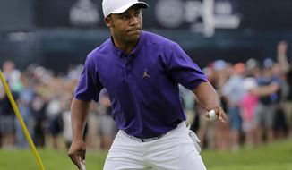 Harold Varner III reacts after sinking a putt for birdie on the first green during the final round of the PGA Championship golf tournament, Sunday, May 19, 2019, at Bethpage Black in Farmingdale, N.Y. (AP Photo/Seth Wenig)