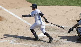 New York Yankees pinch hitter Thairo Estrada hits a three-run double during the sixth inning of a baseball game against the Tampa Bay Rays, Sunday, May 19, 2019, in New York. (AP Photo/Kathy Willens)