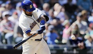 Seattle Mariners' Edwin Encarnacion swings for a three-run home run on a pitch from Minnesota Twins' Trevor May during the seventh inning of a baseball game, Sunday, May 19, 2019, in Seattle. (AP Photo/John Froschauer)