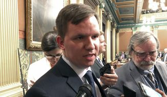 In this Dec. 13, 2018, file photo, Republican Rep. James Lower of Cedar Lake speaks to reporters in Lansing, Mich. Rep. Justin Amash of Michigan, the first Republican in Congress to accuse President Donald Trump of impeachable conduct, is facing a primary challenge from Lower, who announced his candidacy Monday, May 20, 2019, for the 3rd Congressional District in western Michigan. (AP Photo/David Eggert, File)