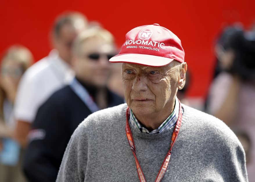 "FILE - In this July 7, 2018, file photo, former Formula One World Champion Niki Lauda of Austria walks in the paddock before the third free practice at the Silverstone racetrack, Silverstone, England. Three-time Formula One world champion Niki Lauda, who won two of his titles after a horrific crash that left him with serious burns and went on to become a prominent figure in the aviation industry, has died. He was 70. The Austria Press Agency reported Lauda's family saying in a statement he ""passed away peacefully"" on Monday, May 20, 2019. (AP Photo/Luca Bruno, File)"