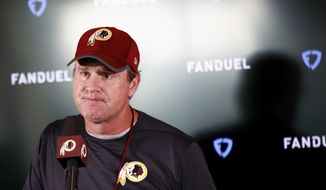 Washington Redskins head coach Jay Gruden speaks at a news conference after a practice at the team's NFL football practice facility, Monday, May 20, 2019, in Ashburn, Va. (AP Photo/Patrick Semansky)