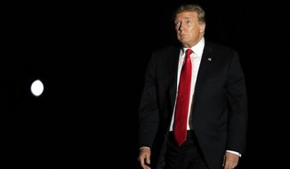 President Donald Trump looks up towards the White White House balcony as he arrives back to the White House in Washington, from a campaign rally in Montoursville, Pa., Monday, May 20, 2019. (AP Photo/Manuel Balce Ceneta)