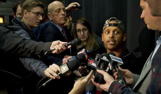 Parkrose High School football coach Keanon Lowe talks to reporters before Game 4 of the NBA basketball playoffs Western Conference finals between the Portland Trail Blazers and the Golden State Warriors, Monday, May 20, 2019, in Portland, Ore. Lowe tackled a student who had pulled a weapon last Friday. Lowe is credited with preventing a shooting at the school. (AP Photo/Craig Mitchelldyer)