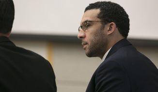Former NFL football player Kellen Winslow Jr. looks at attorney Marc Carlos during his rape trial, Monday, May 20, 2019, in Vista, Calif. (John Gibbins/The San Diego Union-Tribune via AP, Pool)