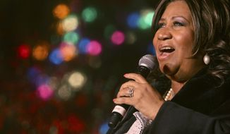 """FILE - In this Dec. 4, 2008 file photo, Aretha Franklin performs during the 85th annual Christmas tree lighting at the New York Stock Exchange in New York. Three handwritten wills have been found in the suburban Detroit home of Franklin, months after the death of the """"Queen of Soul,"""" including one that was discovered under cushions in the living room, a lawyer said Monday, May 20, 2019. (AP Photo/Mary Altaffer, File)"""