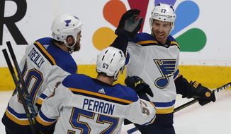 St. Louis Blues' Ryan O'Reilly (90), David Perron (57), celebrate with Jaden Schwartz (17), who scored a goal against the San Jose Sharks in the third period in Game 5 of the NHL hockey Stanley Cup Western Conference finals in San Jose, Calif., on Sunday, May 19, 2019. (AP Photo/Josie Lepe)