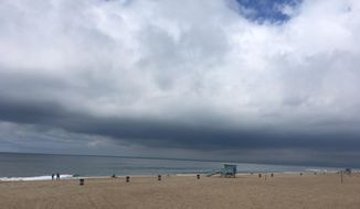 Storm clouds hang low over Manhattan Beach, Calif., Sunday, May 19, 2019, as an unusual late-season weather system brought rain and below-normal temperatures to the Los Angeles region. (AP Photo/John Antczak)