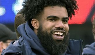 In this Dec. 30, 2018, file photo, Dallas Cowboys' Ezekiel Elliott smiles on the sideline before an NFL football game against the New York Giants, in East Rutherford, N.J. Elliott was handcuffed by police, but not arrested, after a scuffle involving event staff at a Las Vegas music festival. Police Officer Laura Meltzer said Monday, May 20, 2019 that the 23-year-old running back was detained briefly early Saturday during the Electric Daisy Carnival at the Las Vegas Motor Speedway. (AP Photo/Bill Kostroun, file) **FILE**