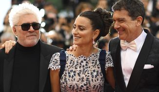 Director Pedro Almodovar, from left, actors Penelope Cruz and Antonio Banderas pose for photographers upon arrival at the premiere for the film 'Pain and Glory' at the 72nd international film festival, Cannes, southern France, Friday, May 17, 2019. (Photo by Arthur Mola/Invision/AP)