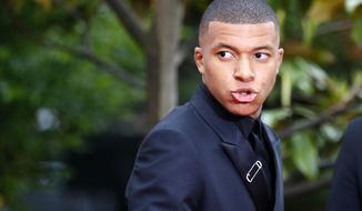 Paris Saint Germain's Kylian Mbappe arrives at the UNFP (Union of French Professional Footballers) ceremony, in Paris, France, Sunday, May 19, 2019. (AP Photo/Francois Mori)