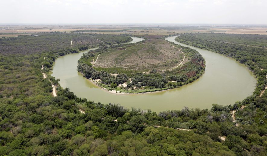 FILE - In this July 24, 2014, file photo, a bend in the Rio Grand is viewed from a Texas Department of Public Safety helicopter on patrol over in Mission, Texas. The U.S. government says a teenage Guatemalan died Monday, May 20, 2019, at a Border Patrol station in South Texas, the fifth death of a migrant child since December. U.S. Customs and Border Protection said in a statement that Border Patrol apprehended the teenager in South Texas' Rio Grande Valley on May 13. The agency says the teenager was found unresponsive Monday morning during a welfare check at the agency's Weslaco, Texas, station. The teenager's cause of death is unknown. (AP Photo/Eric Gay, Pool, File)