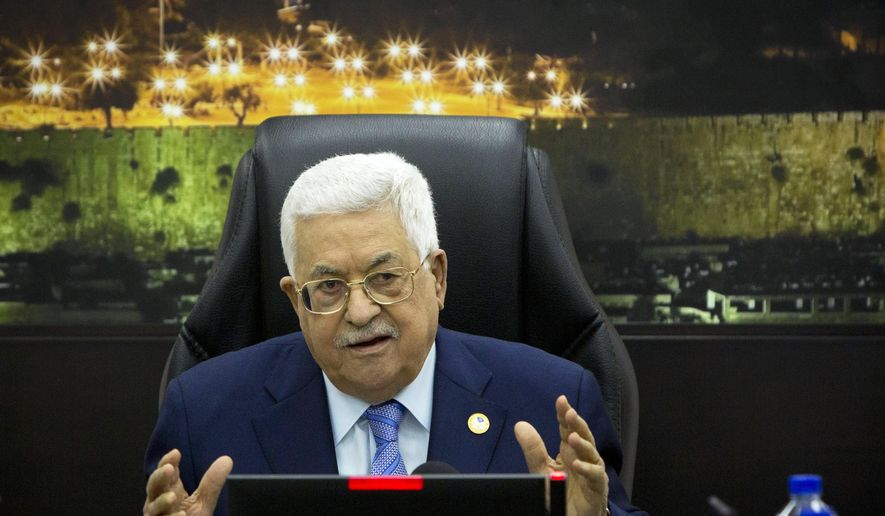 In this April 29, 2019, file photo, Palestinian President Mahmoud Abbas, center, chairs a session of the weekly cabinet meeting in the West Bank city of Ramallah. On Saturday, June 22, 2019, the Trump administration unveiled a $50B proposal to aid the Palestinian economy in hopes of achieving a lasting peace process with Israel. (AP Photo/Majdi Mohammed, Pool, File) **FILE**