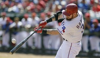 FILE - In this Oct. 3, 2015, file photo, Texas Rangers' Josh Hamilton hits a solo home run during the seventh inning of a baseball game against the Los Angeles Angels in Arlington, Texas. Hamilton will be inducted into the Rangers Hall of Fame on Aug. 17, 2019. (AP Photo/LM Otero, File)
