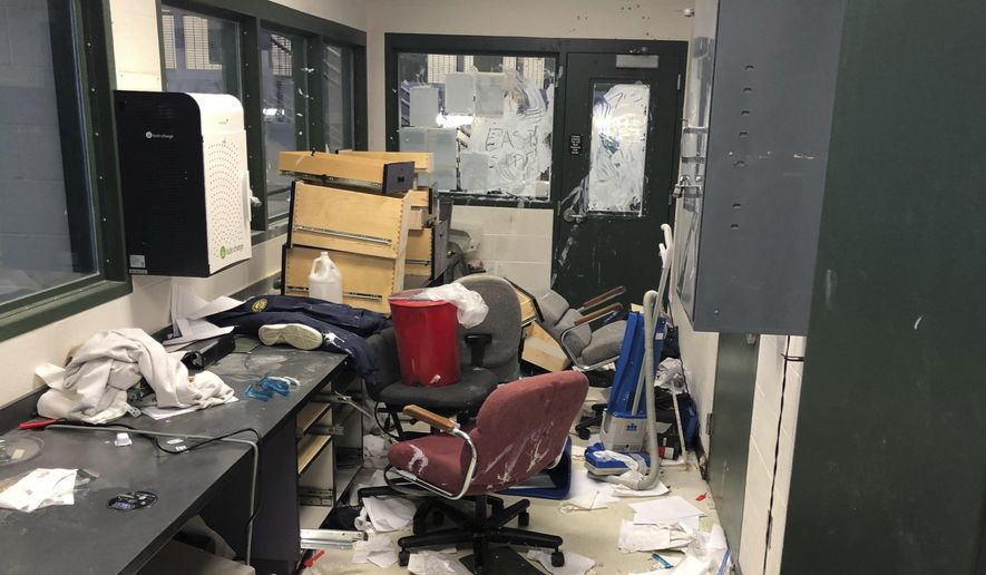 In this Sunday, May 19, 2019, photo provided by the Kansas Department of Corrections, shows damage in a housing unit at the Kansas Juvenile Corrections Complex in Topeka, Kan., following a disturbance there Sunday. Department officials say they still don't know what caused the disturbance adding that 10 young male offenders damaged property inside three living units at the state's juvenile corrections center during the Sunday evening disturbance. Officials also added that the disturbance did not result in any injuries and investigators are still trying to determine the extent of the damage. (Kansas Department of Corrections/Daren Davies via AP)